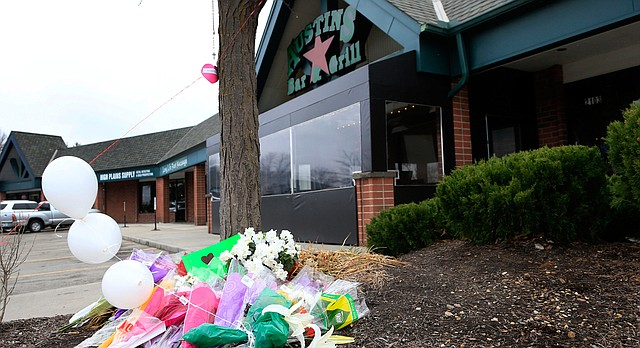 A small memorial for Srinivas Kuchibhotla is displayed outside Austins Bar and Grill in Olathe, Kan., Friday, Feb. 24, 2017. Kuchibhotla was shot and killed at the bar Wednesday, Feb. 22. (AP Photo/Orlin Wagner)