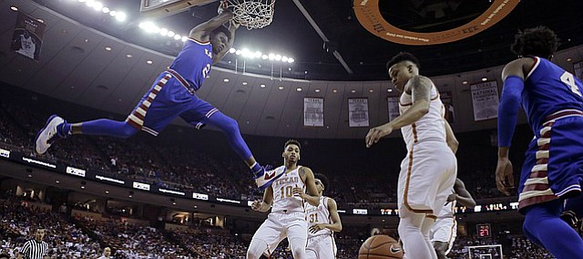 Kansas guard Lagerald Vick (2) scores over Texas guard Eric Davis Jr. (10) during the first half of an NCAA college basketball game, Saturday, Feb. 25, 2017, in Austin, Texas.