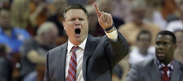 Kansas coach Bill Self calls to his players during the second half of an NCAA college basketball game against Texas, Saturday, Feb. 25, 2017, in Austin, Texas. Kansas won 77-67.