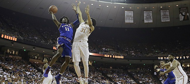 Kansas guard Josh Jackson (11) shoots over Texas forward Jarrett Allen (31) during the first half of an NCAA college basketball game, Saturday, Feb. 25, 2017, in Austin, Texas.