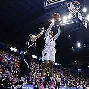 Kansas forward Caelynn Manning-Allen (25) puts up a shot to score in the Jayhawks loss to the Wildcats Saturday, Feb. 25, at Allen Fieldhouse.