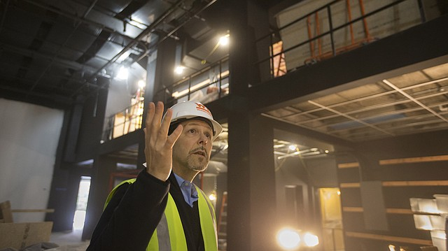 Michael Baskett, associate professor and chair of the University of Kansas department os film and media studies, leads a tour through the new sound stage under construction at Summerfield Hall on Thursday, Feb. 23, 2017. The building, which formerly housed the KU School of Business, is being renovated to accommodate the department of film and media studies and several other KU offices and classrooms.