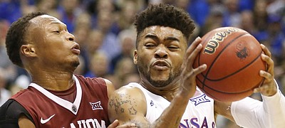 Kansas guard Frank Mason III (0) collides with Oklahoma guard Darrion Strong-Moore (0) on his way to the bucket during the first half, Monday, Feb. 27, 2017 at Allen Fieldhouse