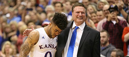 Kansas head coach Bill Self puts his arm around a tearful Kansas guard Frank Mason III (0) as he leaves the court for the final time on Senior Night.