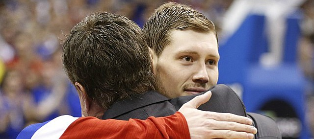 Kansas guard Tyler Self (20) gets a hug from his dad, Bill Self during the senior intros.