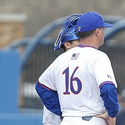 Kansas pitcher Ryan Zeferjahn (22) shows his frustration during a visit to the mound in the first inning on Tuesday, Feb. 28, 2017. Zeferjahn gave up five runs in the inning.