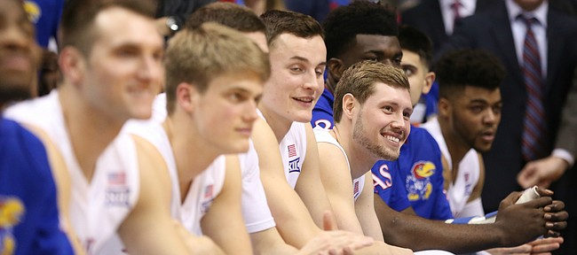 Kansas guard Tyler Self (20) smiles as he listens to his dad talk about him during the Senior Night speeches following the JayhawksÕ 73-63, comeback win over Oklahoma.