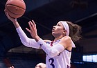 Kansas junior Jessica Washington drives in for a layup during the team's exhibition game against Washburn University on Sunday, Nov. 6, 2016.