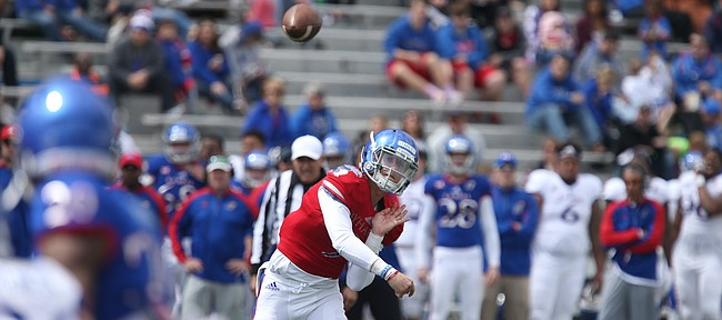 Kansas quarterback Carter Stanley (9) heaves a pass to a  receiver during the Spring Game on Saturday, April 9, 2016 at Memorial Stadium.