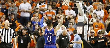 Kansas guard Frank Mason III (0) bids farewell to the OSU student section following the Jayhawks' 90-85 win, Saturday, March 4, 2017 at Gallagher-Iba Arena.