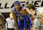 Kansas forward Carlton Bragg Jr. (15) flashes a smile while waiting for a free throw during the first half, Saturday, March 4, 2017 at Gallagher-Iba Arena.