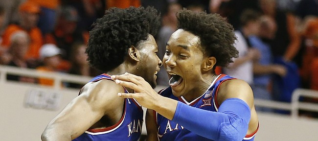 Kansas guard Devonte' Graham (4) and Kansas guard Josh Jackson (11) get airborne to celebrate the Jayhawks' 90-85 win, Saturday, March 4, 2017 at Gallagher-Iba Arena.