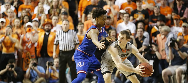 Kansas guard Devonte' Graham (4) pressures Oklahoma State guard Phil Forte III (13) into calling a timeout late in the second half, Saturday, March 4, 2017 at Gallagher-Iba Arena.