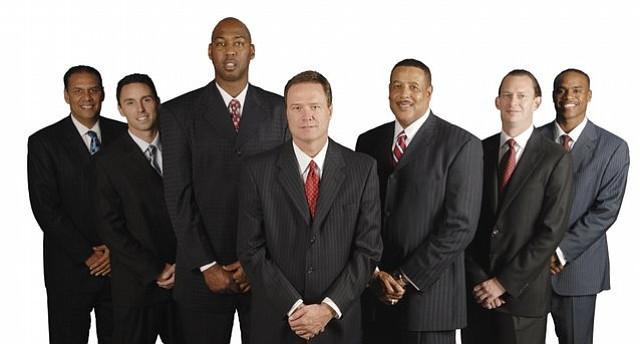 Thad Allender/Journal-World Photo.Kansas coaches Kurtis Townsend, Brett Ballard, Danny Manning, Bill Self, Ronnie Chalmers, Joe Dooley, and Michael Lee.