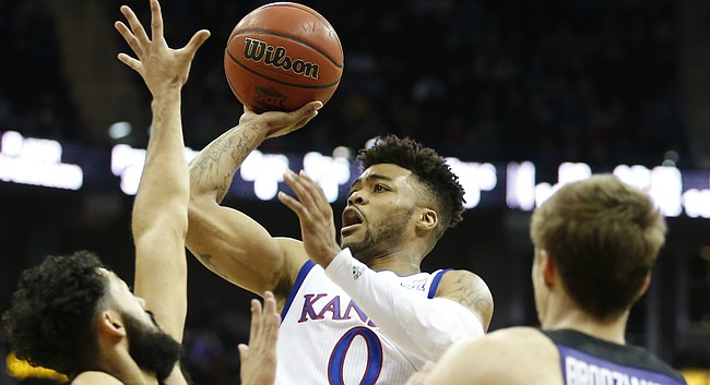 Kansas guard Frank Mason III (0) puts up a floater over TCU guard Alex Robinson (25) during the first half, Thursday, March 9, 2017 at Sprint Center. At right is TCU forward Vladimir Brodziansky (10).