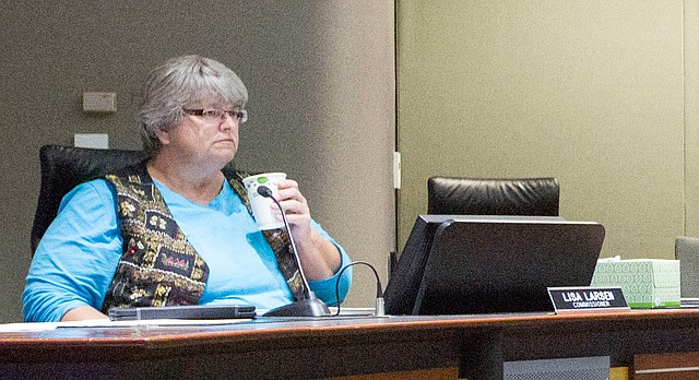 Lawrence City Commissioner Lisa Larsen listens to public comment at a meeting, April 26, 2016, at City Hall.