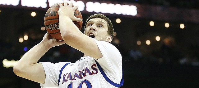 Kansas guard Sviatoslav Mykhailiuk (10) heads in for a bucket past TCU guard Kenrich Williams (34) during the first half, Thursday, March 9, 2017 at Sprint Center.