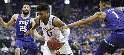 Kansas guard Frank Mason III (0) cuts to the bucket past TCU guard Desmond Bane (1) during the first half, Thursday, March 9, 2017 at Sprint Center.