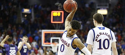 Frustrated, Kansas guard Frank Mason III (0) spikes the ball on the court following the Jayhawks' 85-82 loss to TCU, Thursday, March 9, 2017 at Sprint Center.