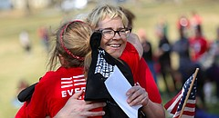 Meg Heriford, Lawrence, owner of Ladybird Diner, front facing, gets a hug from Ruthann Reigle, Lawrence, following Heriford's speech during the local gathering for the International Women's Day Strike on Wednesday, March 8, 2017 at Watson Park. Heriford spoke of her own experience as a survivor of sexual violence at the solidarity event, which had drawn over 200 people shortly after noon.