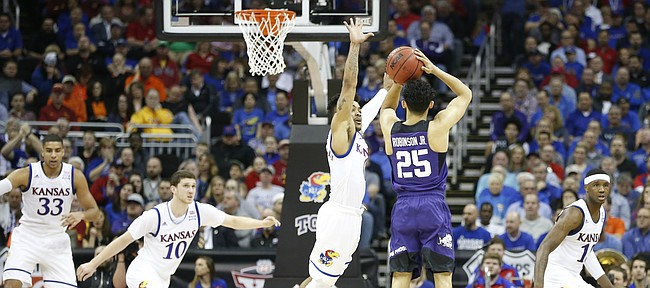 Kansas guard Frank Mason III (0) lunges to defend against a three from TCU guard Alex Robinson (25) during the first half, Thursday, March 9, 2017 at Sprint Center.