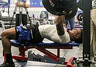 Former Kansas safety Fish Smithson bench presses 225 pounds during the KU football team's pro day workouts on March 13, 2017, at Anderson Family Football Complex.
