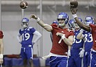 Monday marked the first spring practice for the Kansas football team, including quarterbacks (from left) Carter Stanley, Peyton Bender and Tyriek Starks. The Jayhawks began preparation for head coach David Beaty's third season inside Anschutz Pavilion, on March 13, 2017.