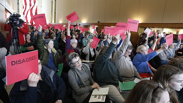 Members of the audience show their opposition to remarks made by U.S. Rep. Lynn Jenkins, R-Kan., during a listening tour on Monday, March 13, 2017 at the Dole Institute of Politics. Many in attendance voiced concerns pertaining to how Republicans in Congress plan to repeal and replace the Affordable Care Act.