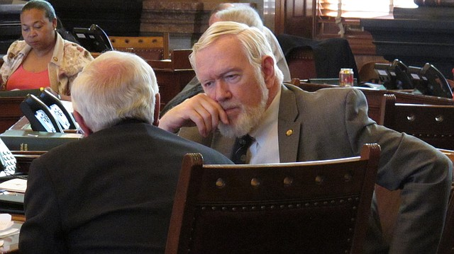 In this AP file photo from Monday, March 21, 2016, Kansas state Sen. Steve Fitzgerald, R-Leavenworth, right, confers with Sen. Rick Wilborn, R-McPherson, during a debate, at the Statehouse in Topeka. (AP File Photo/John Hanna)