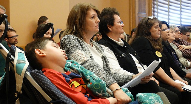 Jill Lane of Great Bend sits with her son Trenton while waiting to testify in favor of a bill that would legalize the use of hemp for the treatment of certain medical conditions, including seizure disorders.