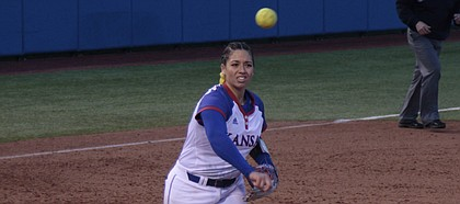 Kansas sophomore pitcher Alexis Reid throws over to first base after fielding a come-backer during the Jayhawks' 5-3 win over UMKC on Thursday at Arrocha Ballpark. Reid earned her ninth win of the season.