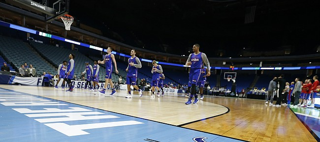 The Jayhawks warm up during a practice on Thursday, March 16, 2017 at BOK Center in Tulsa, Oklahoma.
