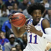 Kansas guard Josh Jackson (11) drives against UC Davis guard Siler Schneider (5) during the first half on Friday, March 17, 2017 at BOK Center in Tulsa, Oklahoma.