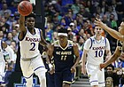 Kansas guard Lagerald Vick (2) pushes the ball up the court to Kansas guard Devonte' Graham (4) during the first half on Friday, March 17, 2017 at BOK Center in Tulsa, Oklahoma.