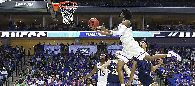 Kansas guard Josh Jackson (11) lunges toward the bucket for a shot during the second half on Friday, March 17, 2017 at BOK Center in Tulsa, Oklahoma.