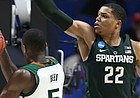 Michigan State guard Miles Bridges (22) defends against a shot from Miami guard Davon Reed (5) during the second half on Friday, March 17, 2017 at BOK Center in Tulsa, Oklahoma.