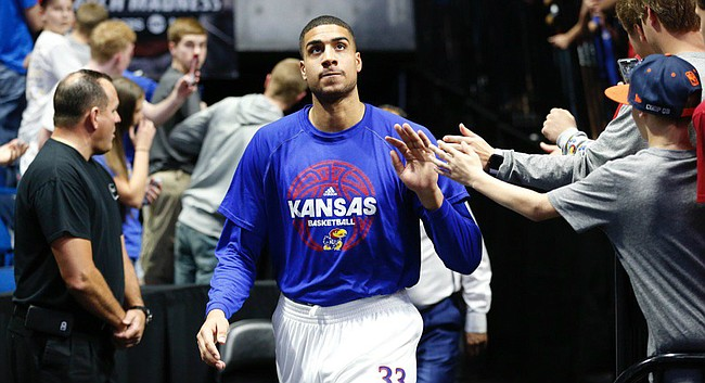 Kansas senior center Landen Lucas walks out onto the floor at the BOK Center ahead of Sunday's game against Michigan State in the second round of the NCAA Tournament.