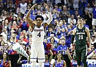 Kansas guard Devonte' Graham (4) raises up the KU fanbase during a run by the Jayhawks in the first half on Sunday, March 19, 2017 at BOK Center in Tulsa, Okla. At right is Michigan State guard Matt McQuaid (20).