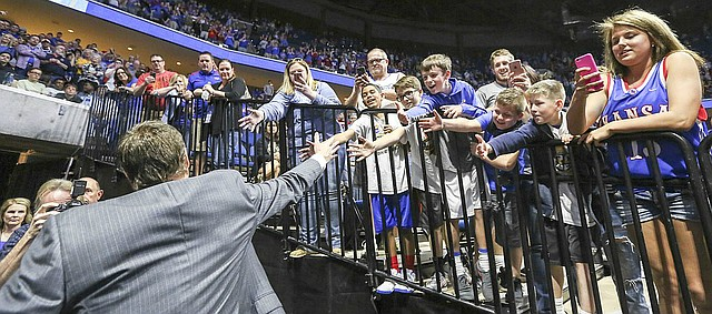 Kansas head coach Bill Self reaches to slap hands with fans after the Jayhawks' 90-70 win over Michigan State on Sunday, March 19, 2017 at BOK Center in Tulsa, Okla.