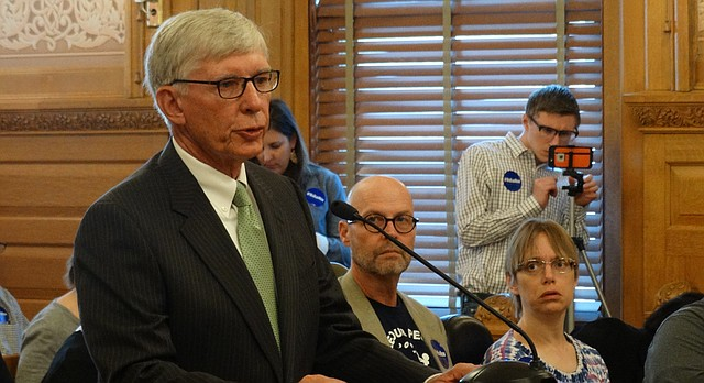 Former Kansas Senate President Dave Kerr, R-Hutchinson, urges his former colleagues in the Senate to pass a bill to expand the state's Medicaid program during a committee hearing Monday.