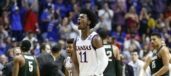 Kansas guard Josh Jackson (11) roars after a Michigan State timeout during a run by the Jayhawks in the second half on Sunday, March 19, 2017 at BOK Center in Tulsa, Okla.