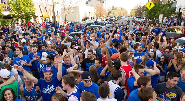 Jayhawk fans flood Massachusetts Street following Kansas' Elite Eight victory over North Carolina, Sunday, March 25, 2012 in downtown Lawrence.
