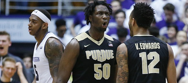 Purdue forward Caleb Swanigan (50) celebrates with forward Vincent Edwards (12) after scoring a basket as Northwestern center Dererk Pardon reacts as he walks to the bench during the second half of an NCAA college basketball game, Sunday, March 5, 2017, in Evanston, Ill. Purdue won 69-65.