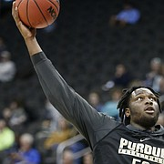 Purdue forward Caleb Swanigan (50) swoops to the bucket during a day of practices and press conferences prior to Thursday's game at Sprint Center in Kansas City, Mo.