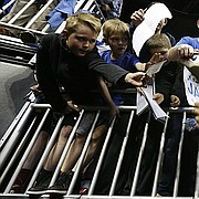 Kansas guard Frank Mason III (0) signs autographs for young Jayhawk fans during a day of practices and press conferences prior to Thursday's game at Sprint Center in Kansas City, Mo.
