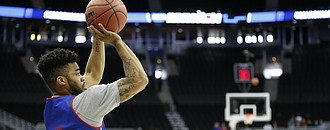 Kansas guard Frank Mason III (0) puts up a three pointer during a day of practices and press conferences prior to Thursday's game at Sprint Center in Kansas City, Mo.