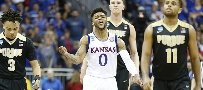 Kansas guard Frank Mason III (0) celebrates a Jayhawk run between Purdue guard Carsen Edwards (3), Purdue guard P.J. Thompson (11) during the first half, Thursday, March 23, 2017 at Sprint Center in Kansas City, Mo.