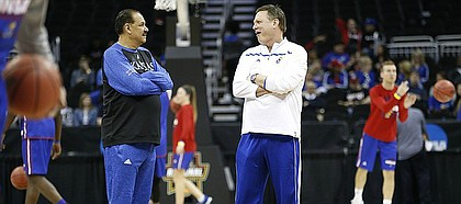 Kansas head coach Bill Self, right, and assistant Kurtis Townsend chat at half court during a day of practices and press conferences prior to a March 2017 KU game at Sprint Center in Kansas City, Mo.