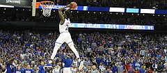 Kansas guard Lagerald Vick (2) spins to deliver a 360 jam on a breakaway during the second half, Thursday, March 23, 2017 at Sprint Center in Kansas City, Mo.