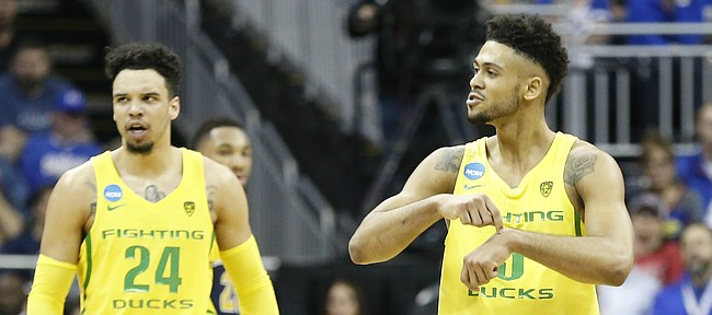 "Oregon guard Tyler Dorsey (5) points to his ""watch"" as the Ducks wrap up the game during the first half, Thursday, March 23, 2017 at Sprint Center in Kansas City, Mo."